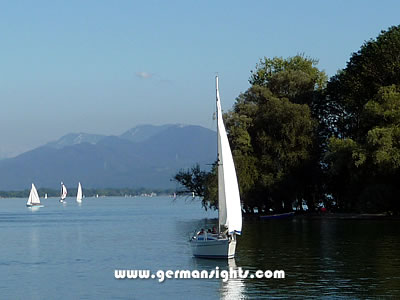 Yachts on the Chiemsee with the Alps in the background